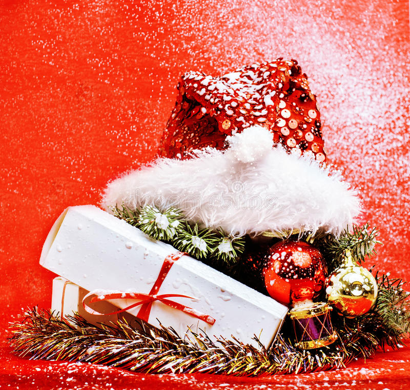 New year celebration, Christmas holiday stuff, tree, toys, decoration with snow isolated, santas red hat. Close up stock images