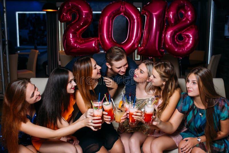 New Year 2018 celebration. Happy company royalty free stock photography