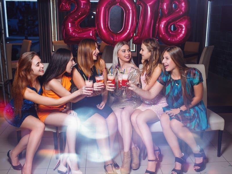New Year 2018 celebration. Happy girls company royalty free stock photography