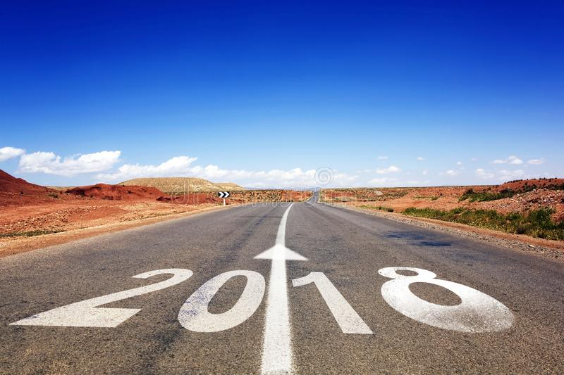 2018 New Year celebration on the road asphalt. New Year arrival concept stock images