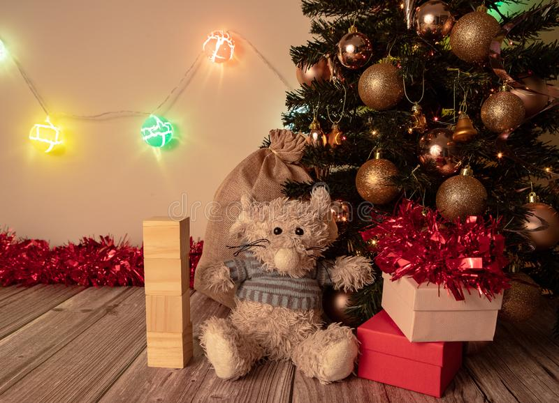 New Year - Chinese year of the rat. Decorated Christmas and New Year tree on a wooden table, with glowing balls on the background. Sparkles, presents and other stock photography