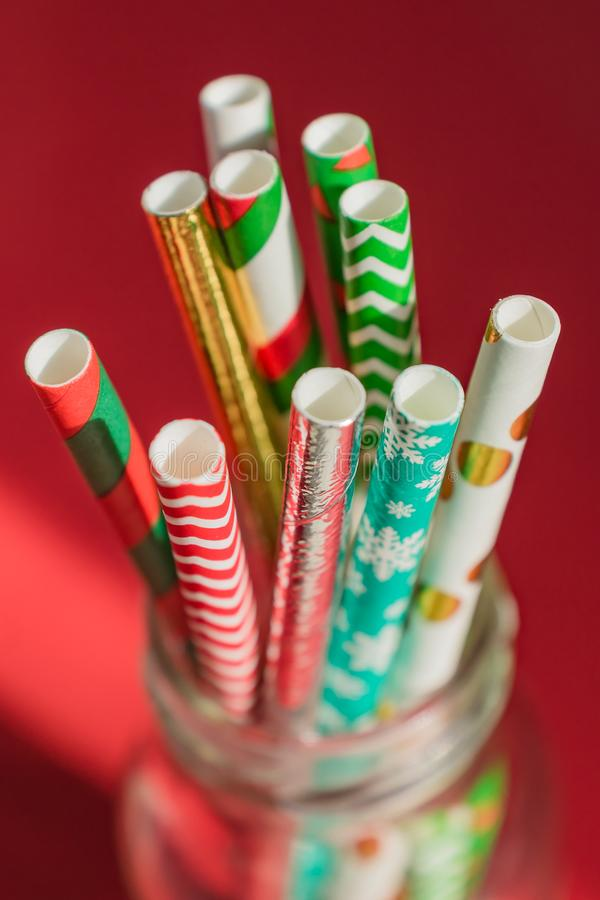 New Year Christmas background. Celebration drinking cocktail party straws in glass bottle stock image