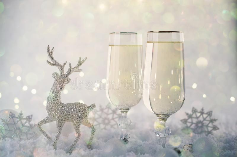 New Year and Christmas Celebration .Two Champagne Glasses and Holiday decoration. Beautiful shiny place setting for Christmas. stock photography