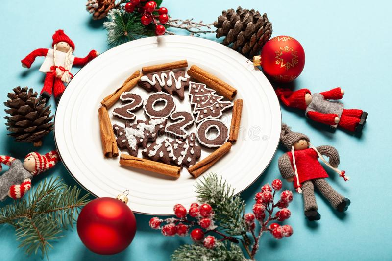 New Year and Christmas chocolate gingerbread cookies in silhouette of 2020. Homemade delicious bakery, sweet family time and stock photo