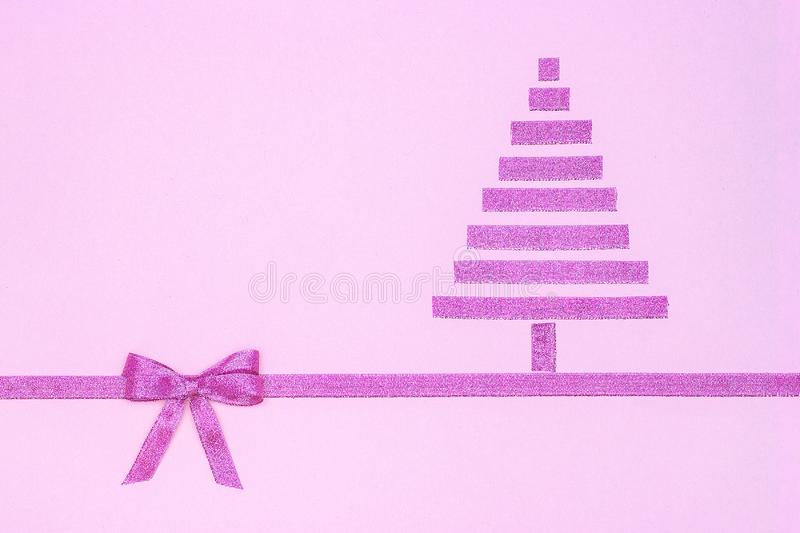 New year and christmas composition. Abstract purple christmas tree from decorative shiny ribbon with bow on pink stock illustration