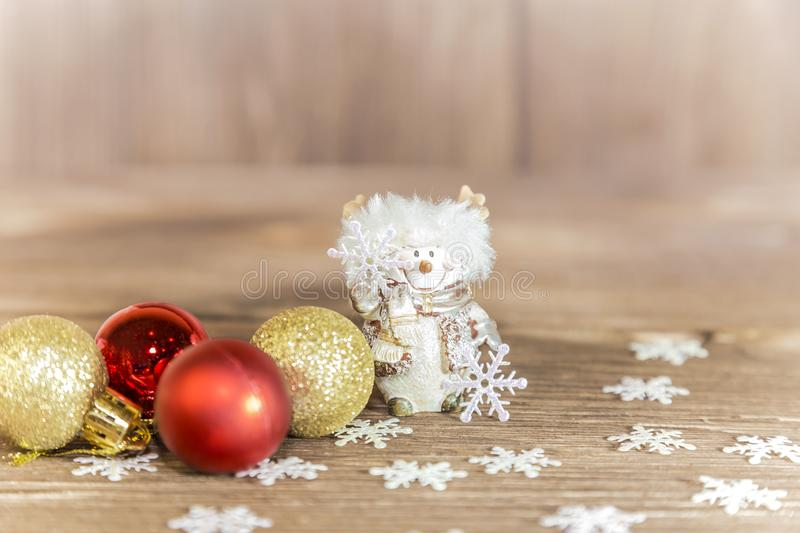 New Year and Christmas composition on a beige background. Holiday decor - Snowman, snowflakes and Christmas balls. stock photography