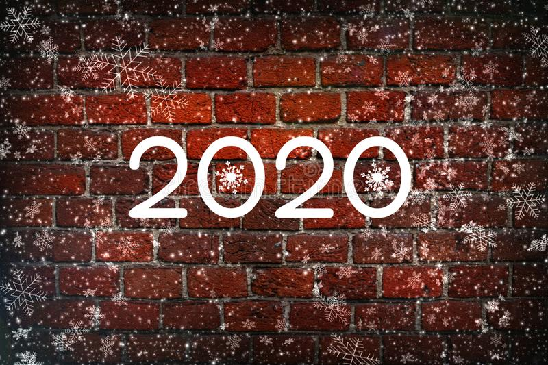 The new year is 2020. Christmas composition, the concept of the New year. Lettering 2020 red background with painted snow and snow stock images