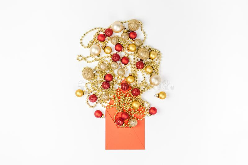 New Year or Christmas composition flat lay top view Xmas holiday celebration decorative toy balls sparkles isolated white paper stock photography