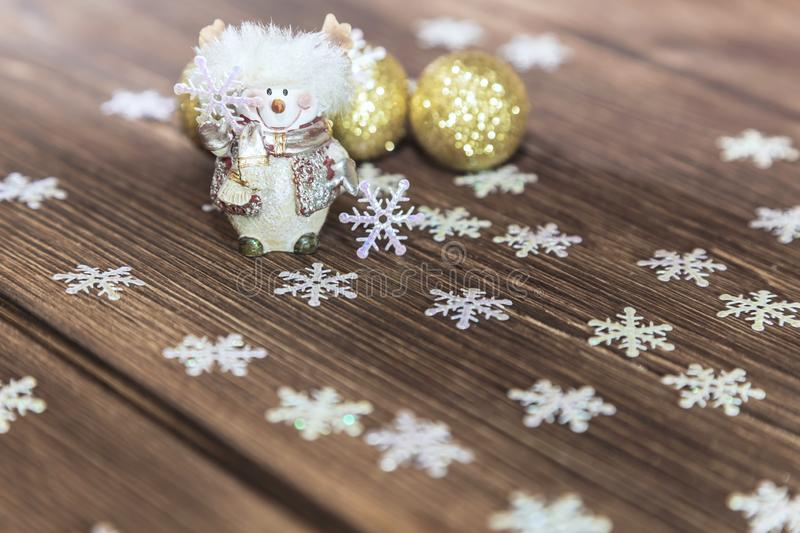 New Year and Christmas composition on a wooden background. Holiday decor - Snowman, snowflakes and Christmas balls. stock photo