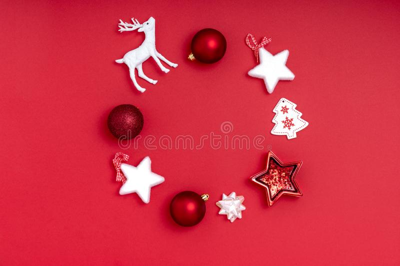 New Year and Christmas composition. Wreath on red background. Top view, flat lay, copy space royalty free stock photography