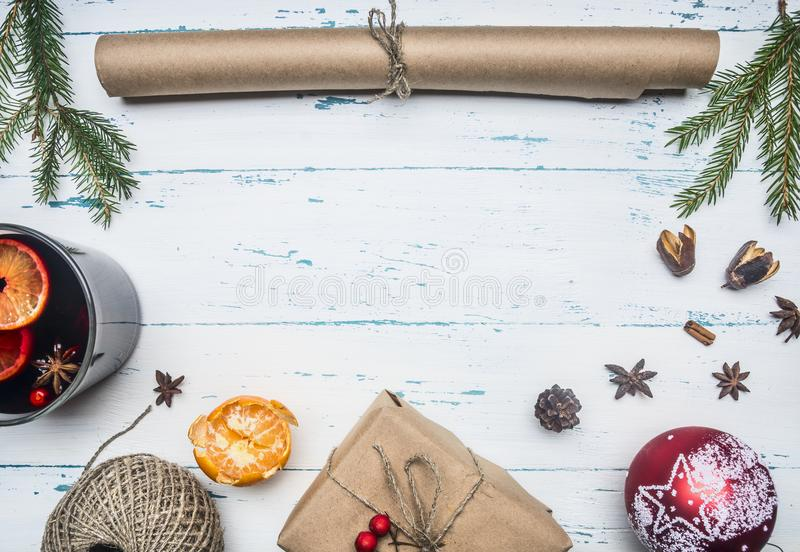 New Year or Christmas concept, roll wrapping paper, mulled wine cup, gift wrapped, tangle of twine, Christmas toys, mandarins, on stock photography