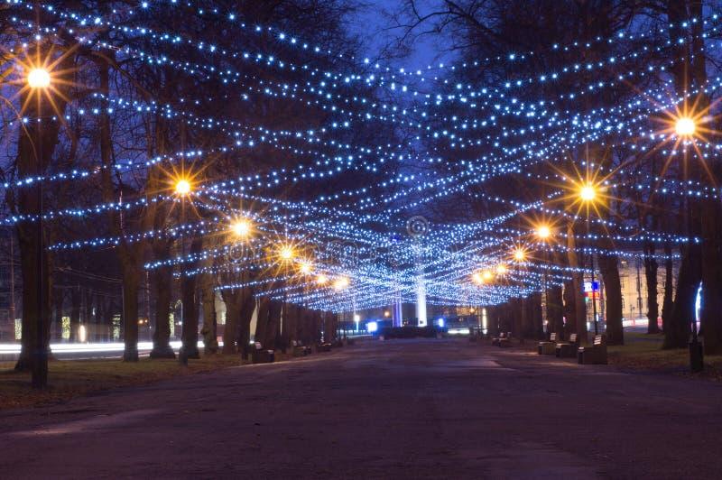 New Year and Christmas festoon illumination. On city alley royalty free stock photo