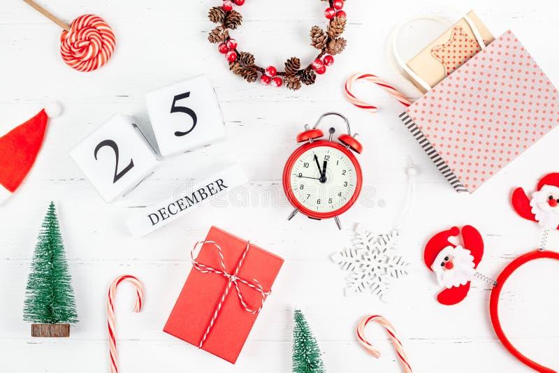 New Year or Christmas flat lay wooden calendar. New Year or Christmas pattern flat lay top view red alarm clock twelve midnight Xmas holiday celebration white royalty free stock image