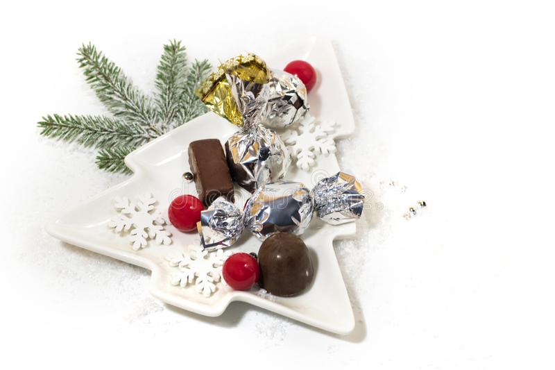New Year, Christmas holiday card. Ceramic dish Christmas tree chocolate, silver candy stock photo