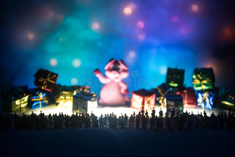 New year or Christmas holiday shopping concept. Store promotions. Silhouette of a large crowd of people watching at a big shopping stock photo