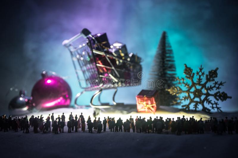 New year or Christmas holiday shopping concept. Store promotions. Silhouette of a large crowd of people watching at a big shopping stock photography