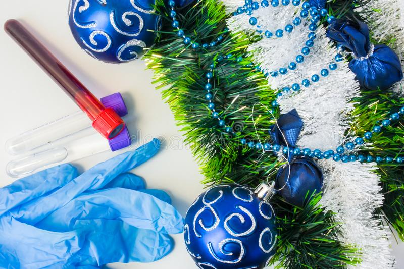 New Year and Christmas in medical, clinical or scientific laboratory. Protective gloves and laboratory test tubes with blood sampl. Es or other biological fluids royalty free stock photography