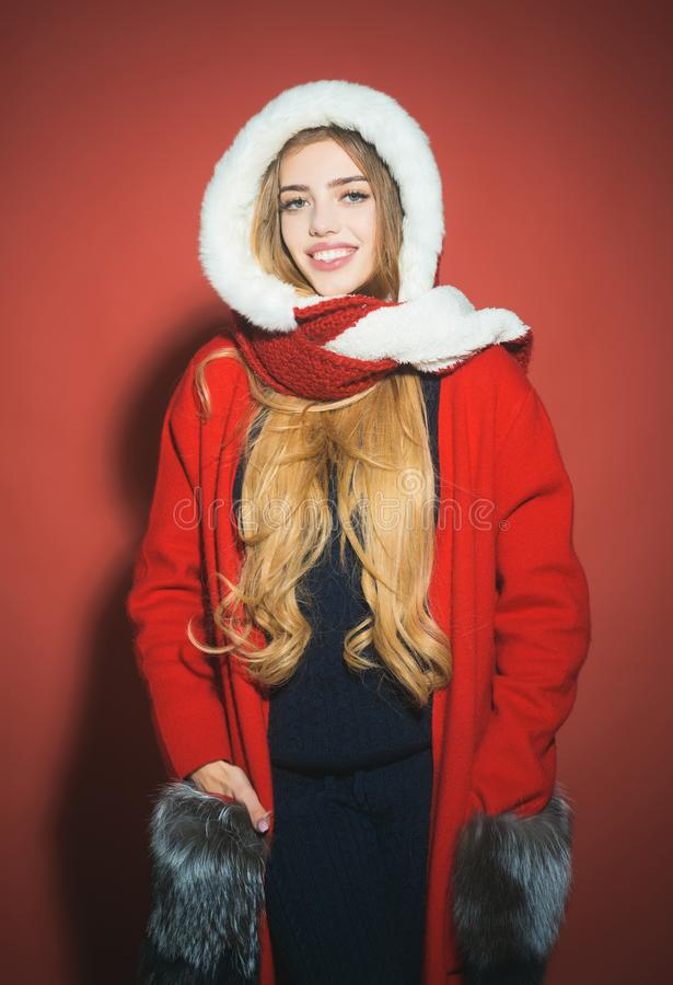 New year and christmas. Woman in santa costume with pretty face. Happy girl celebrate new year on red background. Xmas party and winter holiday. Christmas stock photos
