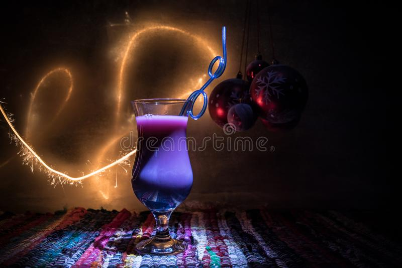 Different tasty cocktails with creative New Year holiday artwork decoration on background. Colorful cocktail in glass. Party club. New Year and Christmas party stock image