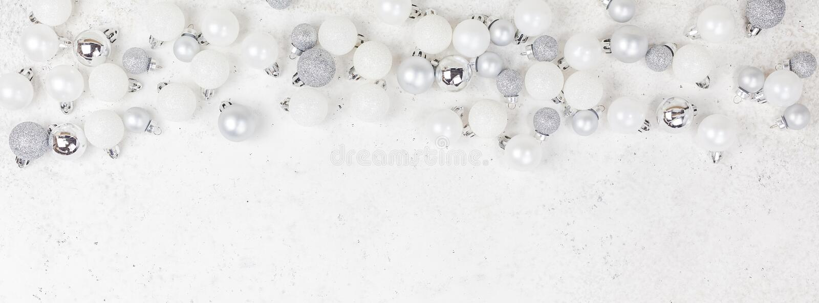 New Year or Christmas pattern flat lay top view Xmas holiday celebration decorative toy balls sparkles white concrete background. Copy space Template frame for stock image