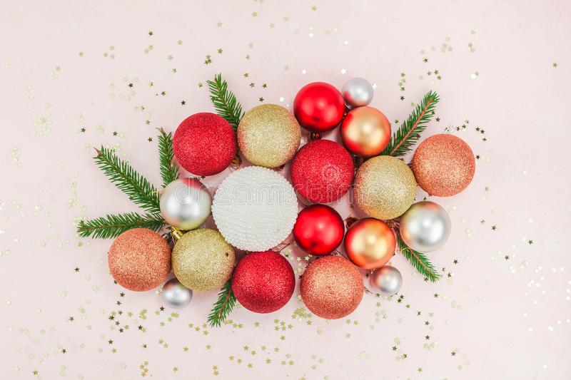 New Year or Christmas pattern flat lay top view Xmas holiday celebration pearl decorative toy balls sparkles confetti pink paper. Background copy space Template royalty free stock image
