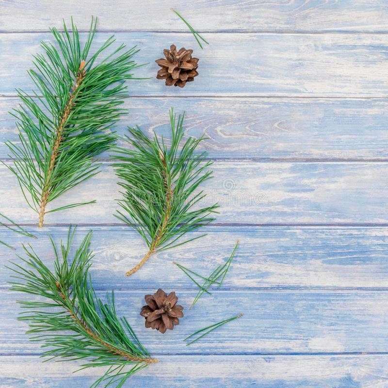 New Year Christmas pattern flat lay top view Xmas holiday handmade handicraft texture with fir tree pine branches cones blue royalty free stock photography