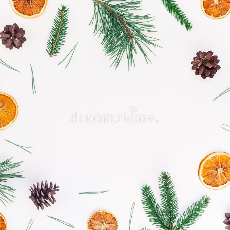New Year Christmas pattern flat lay top view Xmas holiday handmade handicraft texture with fir tree pine branches cones dried. Oranges white background copy stock photo