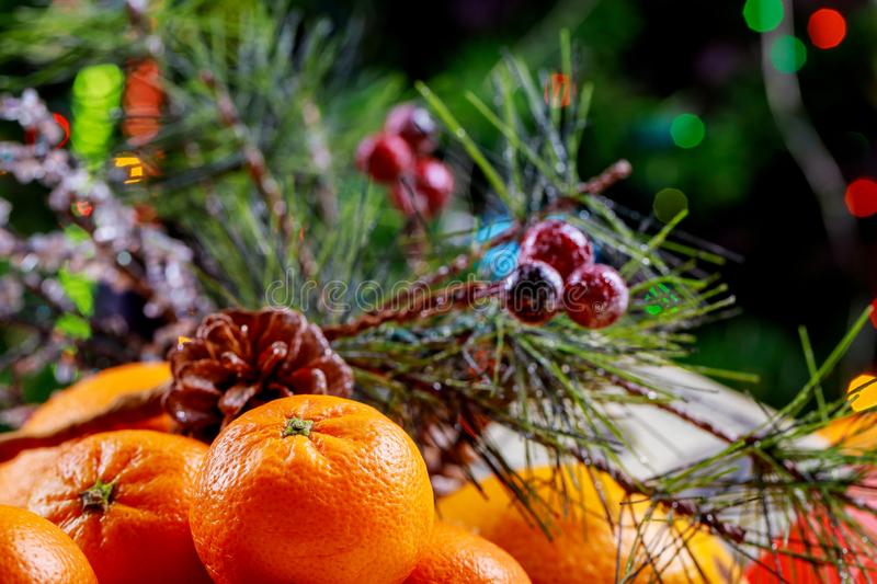 New Year and Christmas tree with gifts and mandarins stock photo