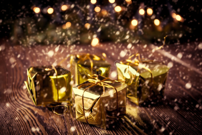 New year, Christmas vintage background. Christmas gifts box on wooden table. Retro toned royalty free stock photos