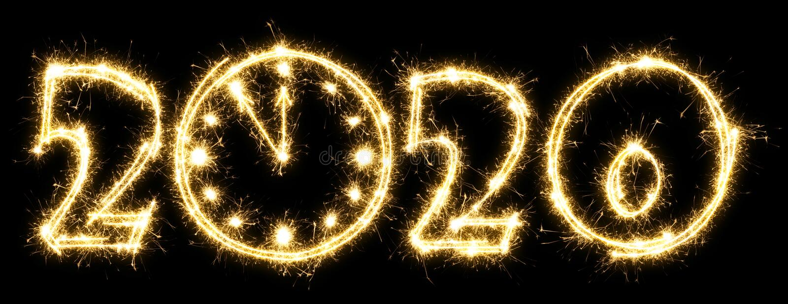New Year 2020 with clock made by sparkler . Number 2020 and sign written sparkling sparklers . Isolated on a black background . royalty free stock photo