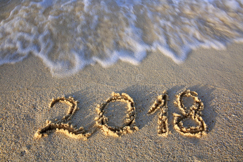 2018 Inscription Written In The Wet Beach Sand With Sea Water Wave.
