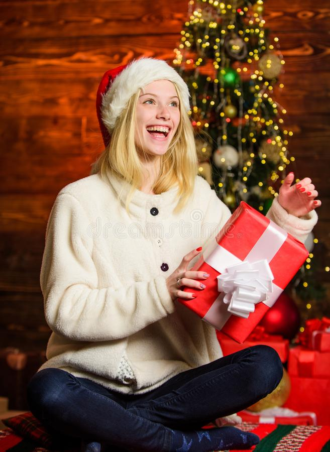 New year is coming. Happy smiling woman and gift box. Happy moments. Happiness and joy. Thrilling emotions. Merry stock photo