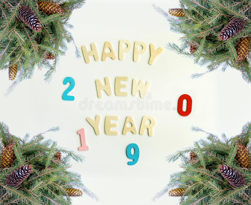 New Year composition with 2019 numbers in a frame of green fir-tree branches with cones. New Year decorative composition with 2019 numbers in a frame of green royalty free stock image