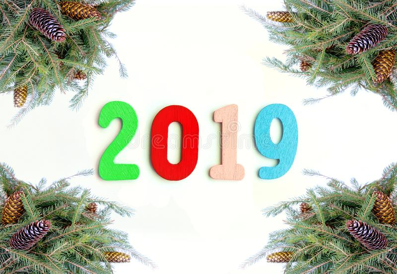 New Year composition with 2019 numbers in a frame of green fir-tree branches with cones. New Year decorative composition with 2019 numbers in a frame of green stock images
