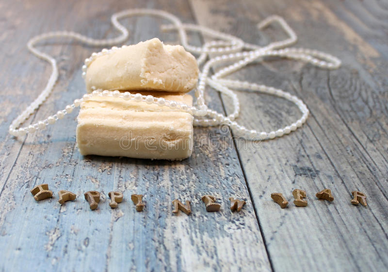 New Year composition shortbread biscuit and white pearl beads royalty free stock images