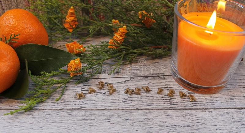 New Year composition with tangerines, arborvitae branch, candles and Christmas trees stock image