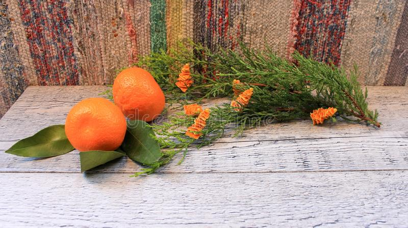 New Year composition with tangerines, arborvitae branch, candles and Christmas trees stock images