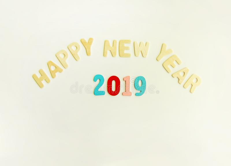 New Year composition with wooden 2019 numbers and letters. Happy New Year festive card. New Year decorative composition with wooden 2019 numbers and letters stock photography