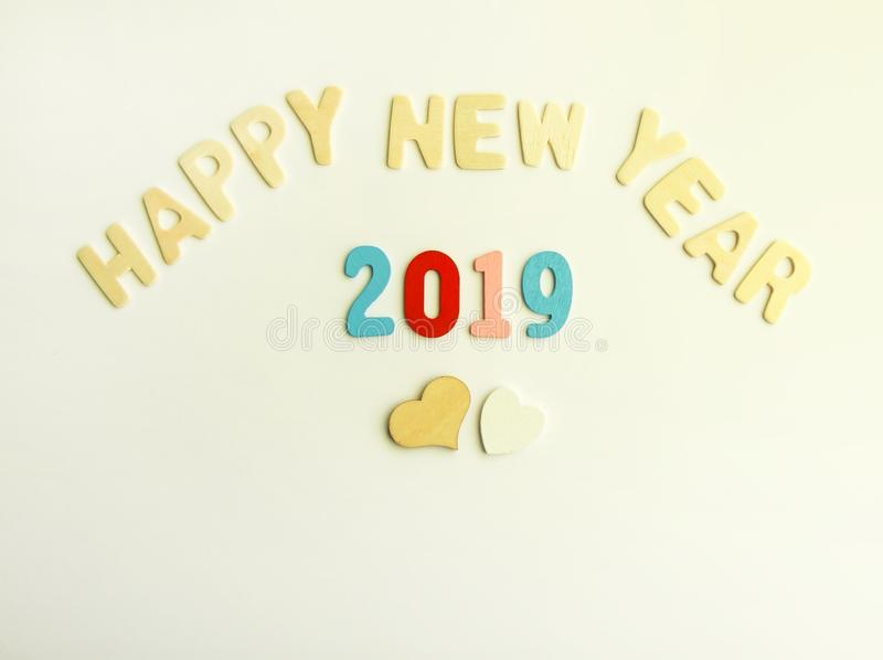 New Year composition with wooden 2019 numbers and letters. Happy New Year festive card. New Year decorative composition with wooden 2019 numbers and letters stock photo