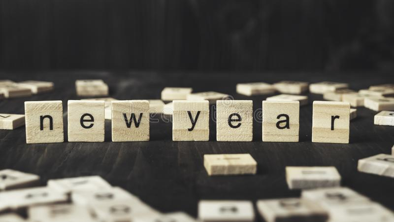 New Year Concept - ' New Year' written on wooden blocks. Close up stock image