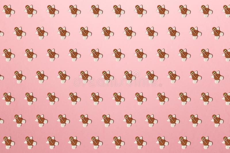 New Year concept. Trendy pattern made with Christmas gingerbread man on bright light pink background. Minimal creative concept. Creative Christmas decoration royalty free stock photos