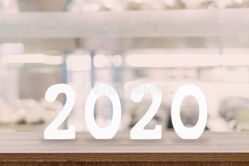 2020 New Year concept - wooden word ` 2020 ` on table and blur light background royalty free stock image