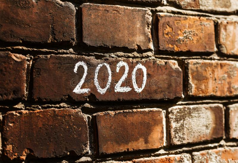 2020 new year concept written on the bricks wall stock photography