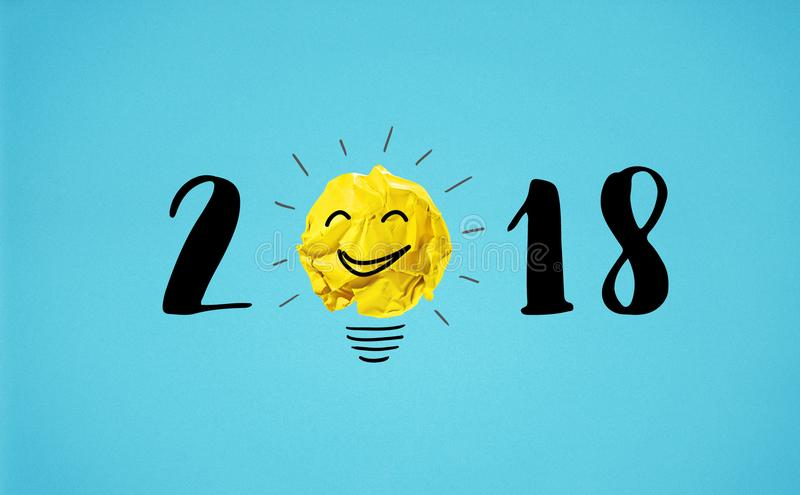 2018 new year concept with yellow crumpled paper ball royalty free stock images