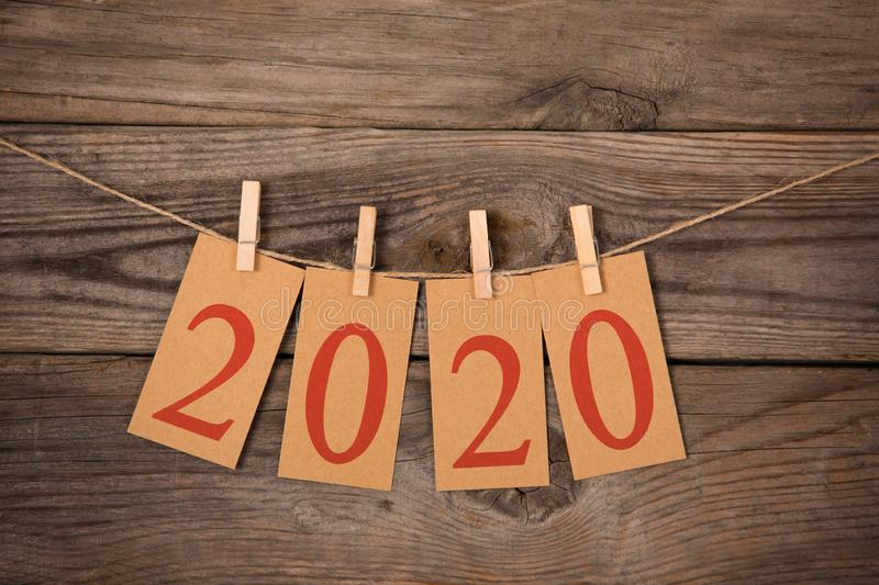 New Year 2020 Concepts Clipped Cards on Wood. New year concepts royalty free stock image