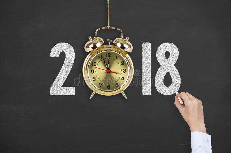 New year concepts countdown clock on blackboard background. New year working stock image