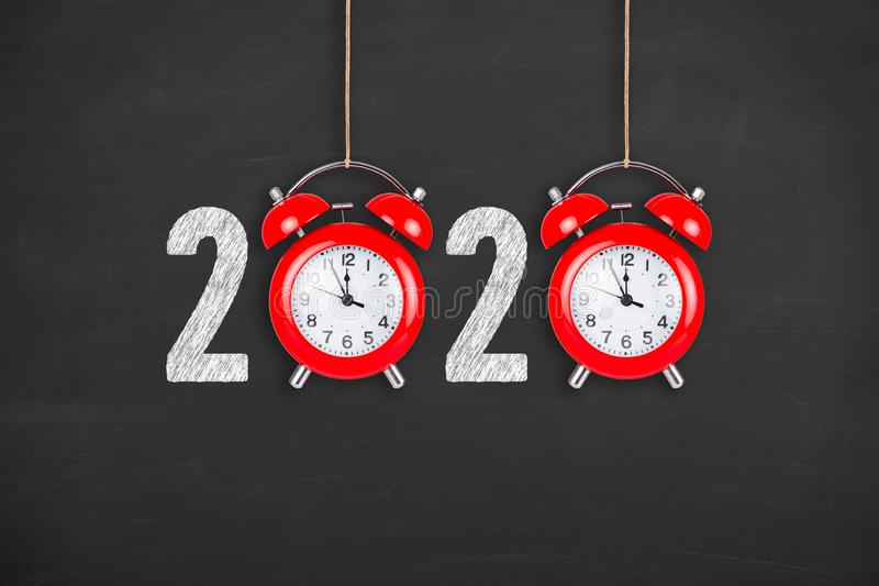 New year concepts 2020 countdown clock on chalkboard background. New year concepts stock photography