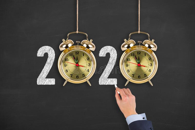 New year concepts 2020 countdown clock on chalkboard background royalty free stock photo