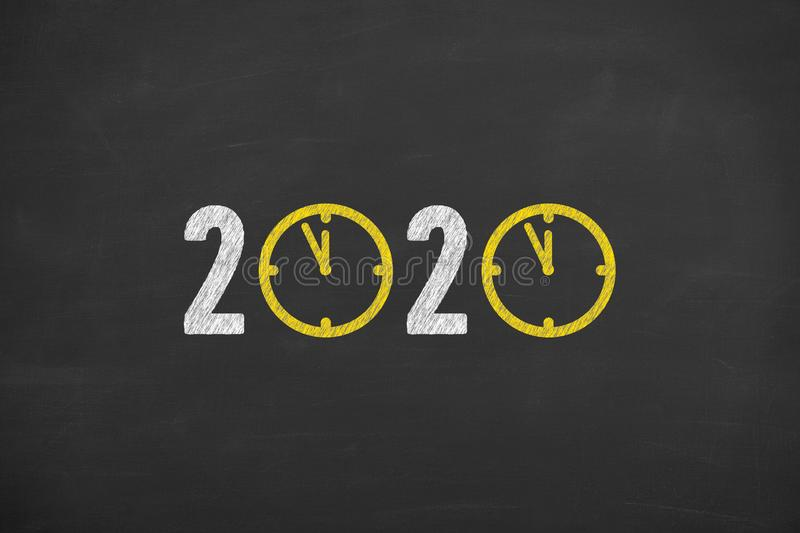 New year concepts 2020 countdown clock over  on chalkboard background. New year concepts royalty free stock photography