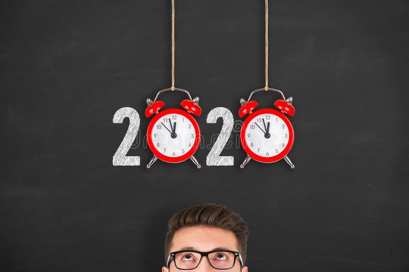 New year concepts 2020 countdown clock over human head on blackboard. New year concepts royalty free stock images
